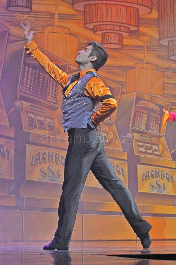 Male dancer in a show. Singers and dancers in production show onboard cruise ship Adventure of the Seas stock image
