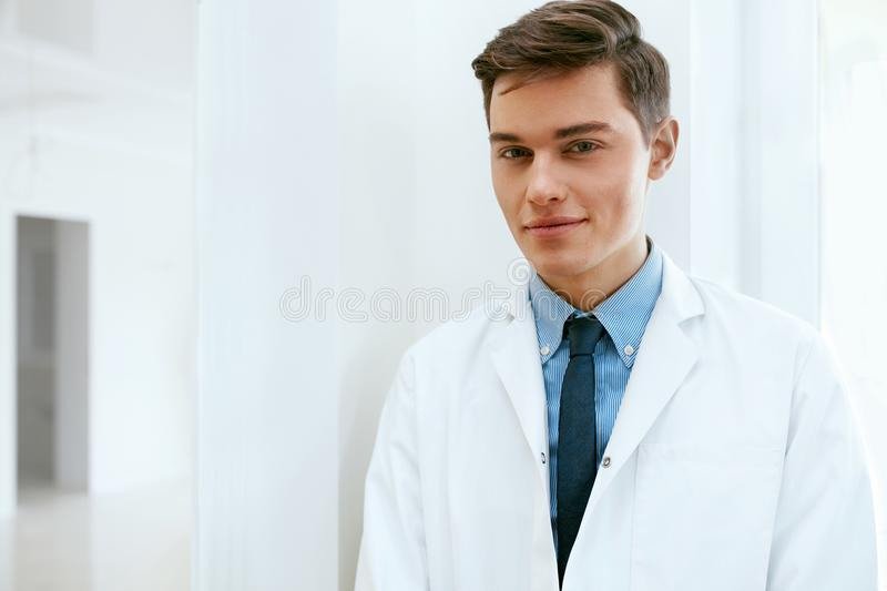Male Dentist Doctor In Dental Clinic. Portrait stock photo