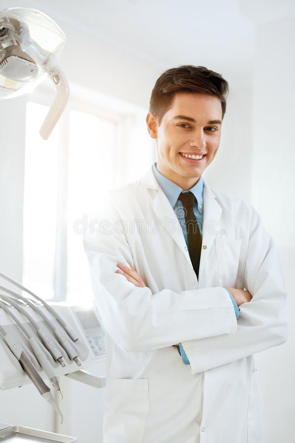 Male Dentist Doctor In Dental Clinic. Portrait royalty free stock photo