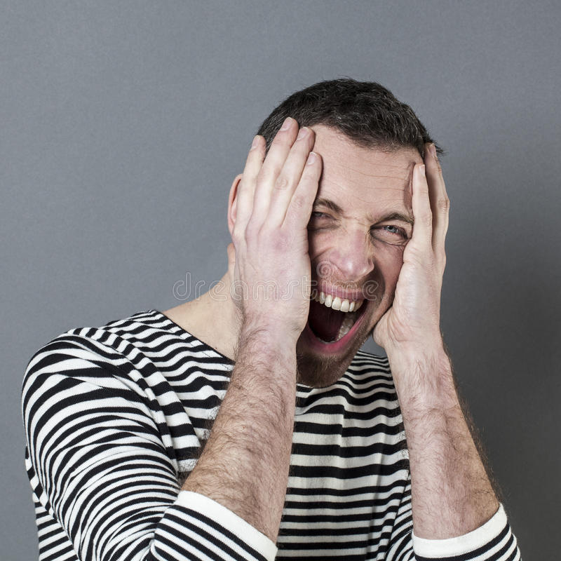 Male disaster concept for enraged middle age man. Male disaster concept - enraged middle age man screaming,expressing his surprise and anger in holding his head stock image