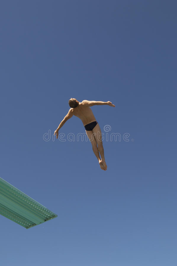Male Diver Diving Backwards royalty free stock photography