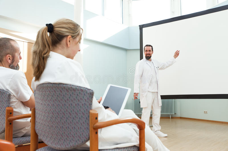 Male doctor is doing a lecture stock photos