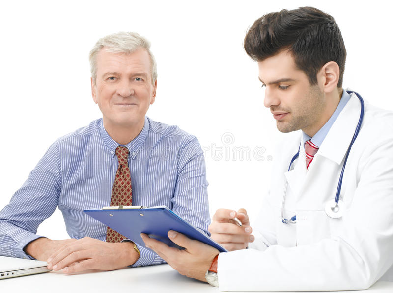 Male doctor with elderly patient stock image