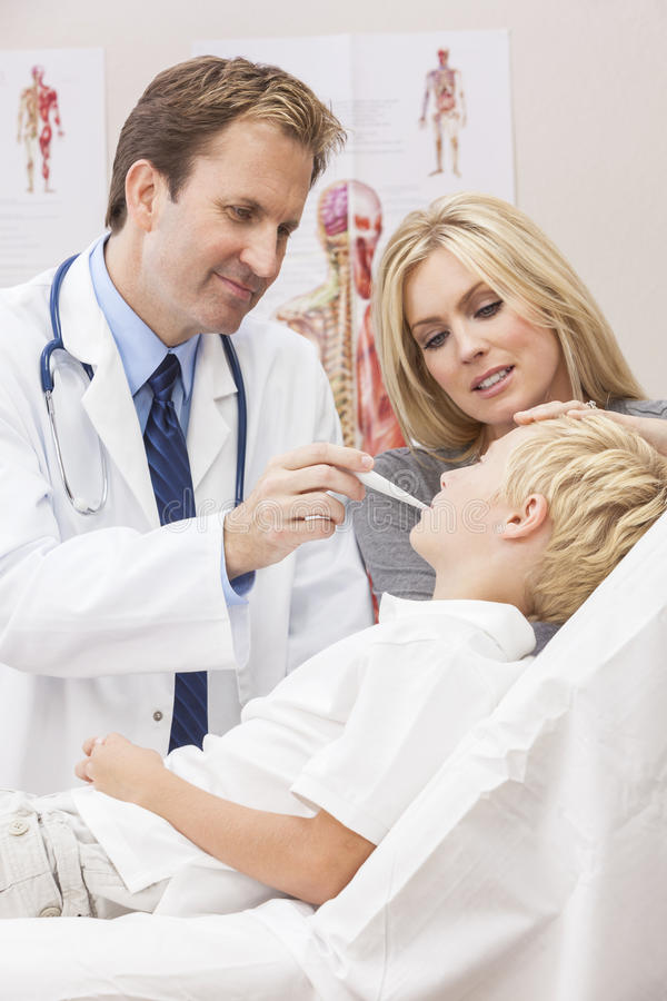 Male Doctor Examining Boy Child With Mother Royalty Free Stock Photo