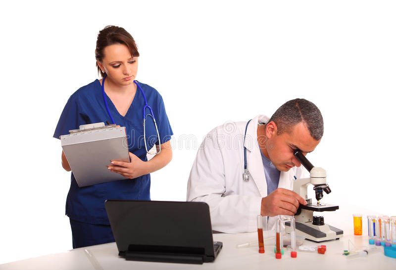 Male Doctor and Female Nurse discussing findings