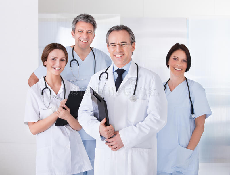 Male doctor in front of team stock images