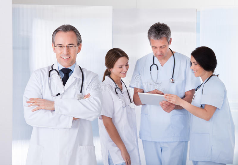 Male doctor in front of team royalty free stock photos