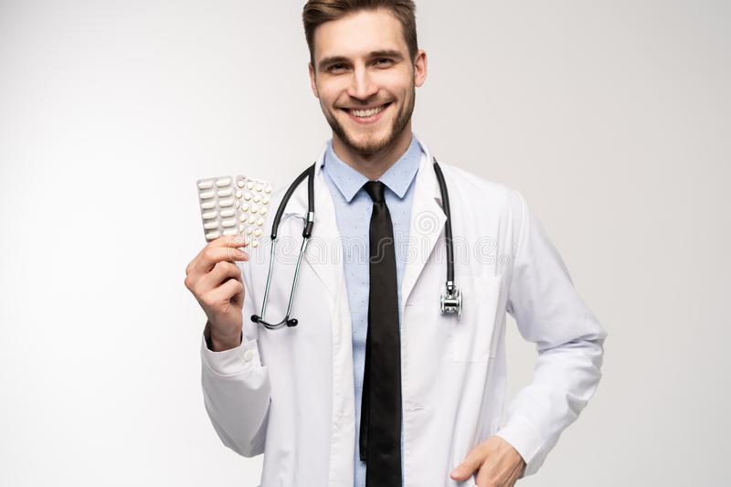 A male Doctor holding pill medical health care pharmacy concept. royalty free stock photo