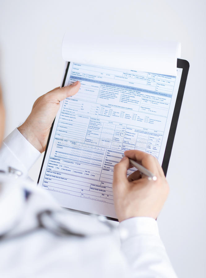 Download Male Doctor Holding Prescription Paper In Hand Royalty Free Stock Photography - Image: 32480277