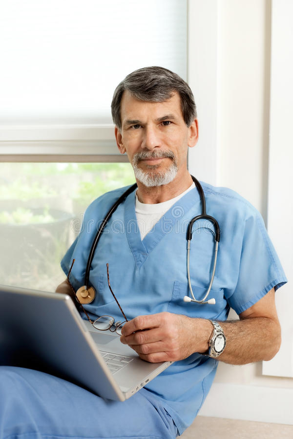 Male Doctor With Laptop Portrait Royalty Free Stock Image