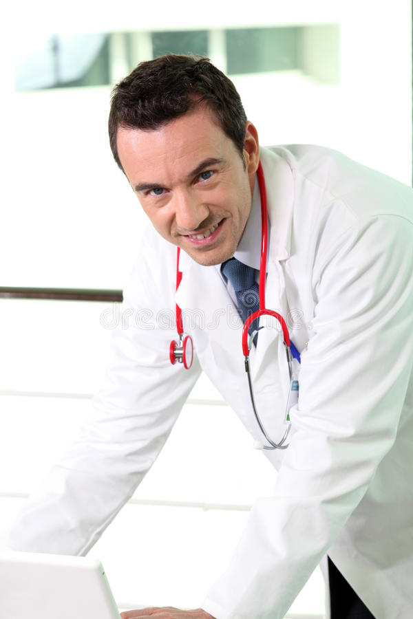 Male doctor in office stock photos