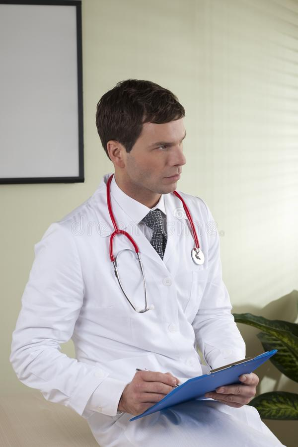 Download Male doctor with paperwork stock image. Image of worker - 14950271