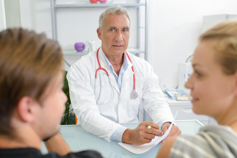Male doctor and patient stock photography