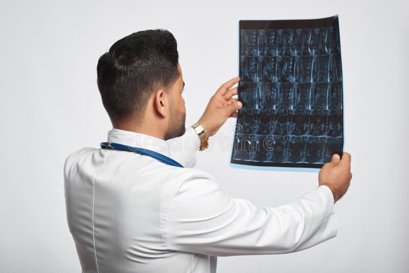 Male doctor posing at studio stock photo