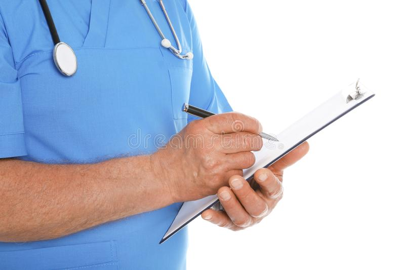 Male doctor in scrubs with stethoscope and clipboard  on white. Medical staff. Male doctor in scrubs with stethoscope and clipboard  on white, closeup. Medical stock photography