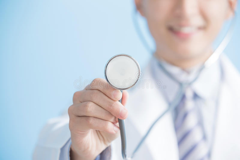 Male doctor show stethoscope royalty free stock photo