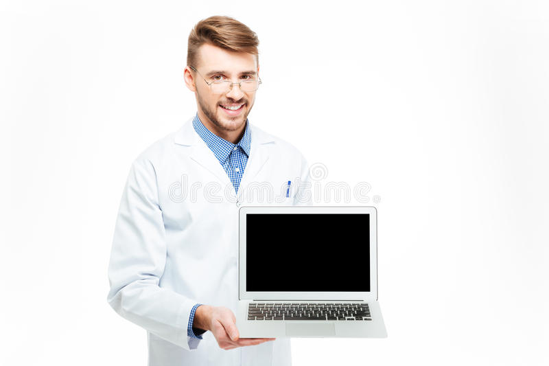 Male doctor showing blank laptop computer screen stock image