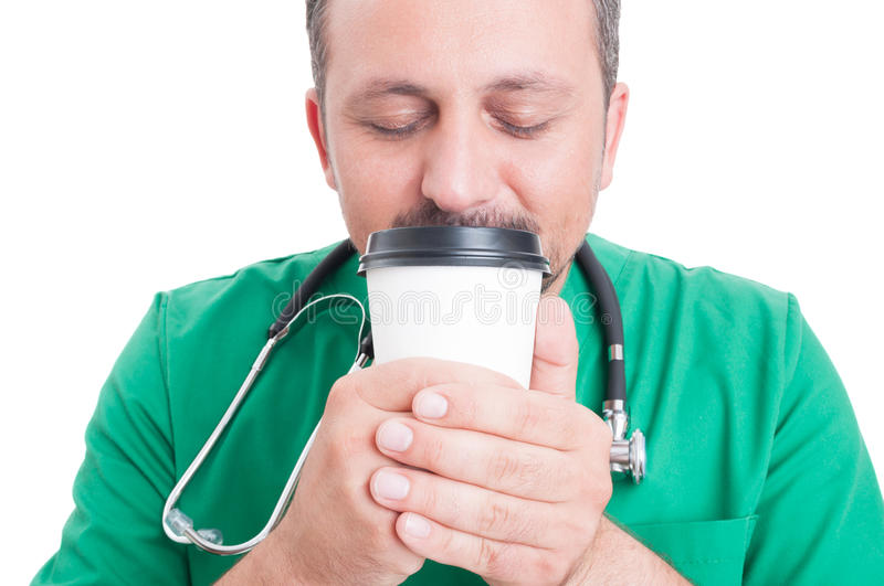 Male doctor smelling fresh coffee stock image