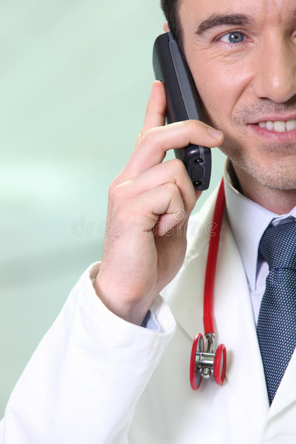 Doctor on the phone. Male doctor speaking on the phone stock photos
