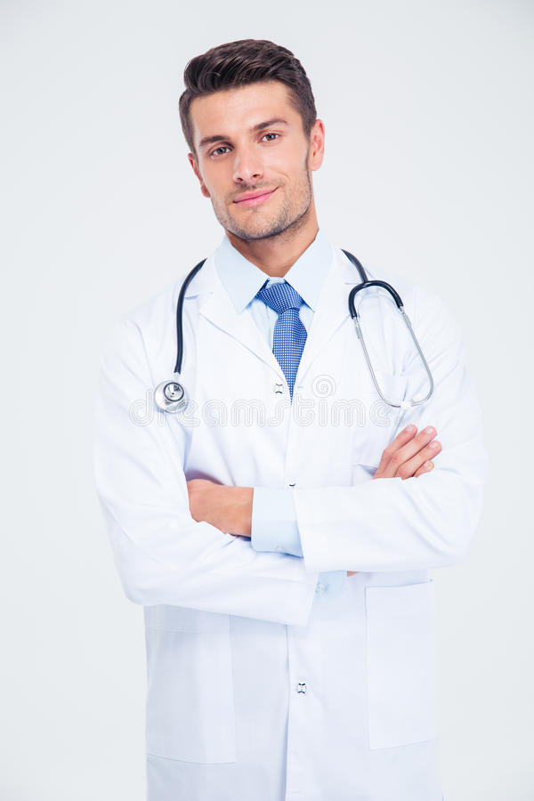 Male doctor standing with arms folded stock photos