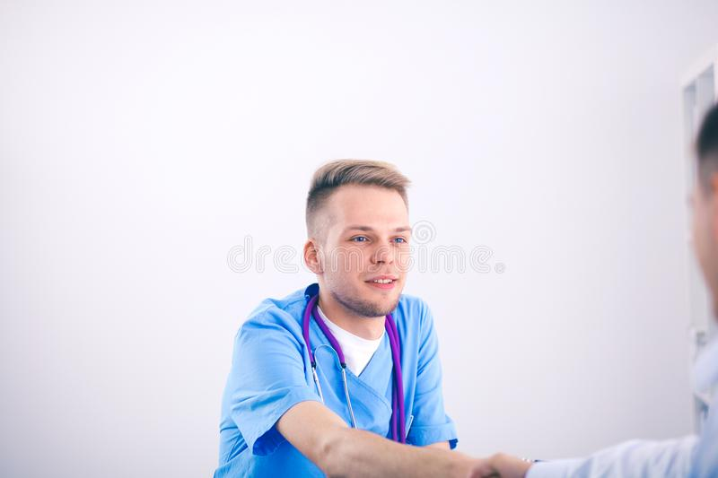 Male doctor standing with folder, isolated on white background. Male doctor.  stock photo
