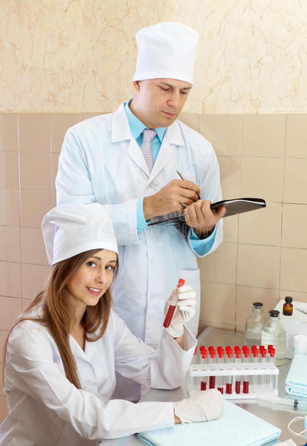 Download Male Doctor Supervises The Nurse Royalty Free Stock Photos - Image: 28055428