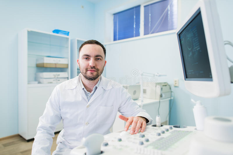 Male doctor with ultrasonic equipment during ultrasound medical examination.  stock photography