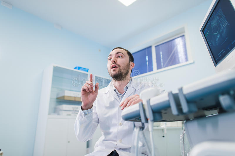 Male doctor with ultrasonic equipment during ultrasound medical examination.  royalty free stock image