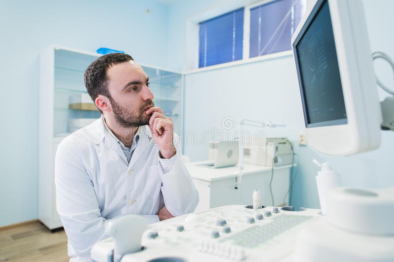 Male doctor with ultrasonic equipment during ultrasound medical examination.  stock images