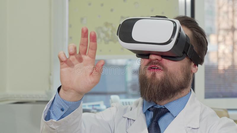 Male doctor using 3d virtual reality glasses at the hospital royalty free stock photo