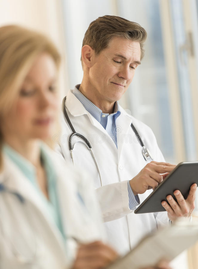 Male Doctor Using Digital Tablet At Hospital royalty free stock photos