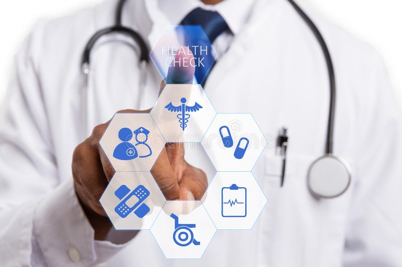Male doctor using finger to choose health check button stock image