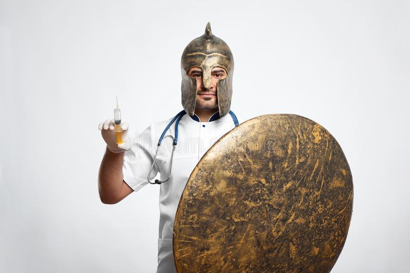 Male doctor wearing medieval armor royalty free stock image