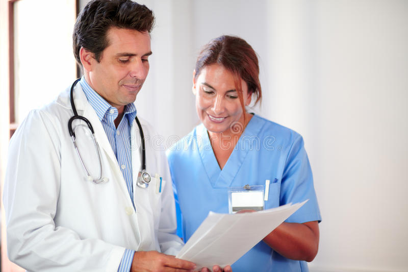 Male doctor working with female nurse royalty free stock images