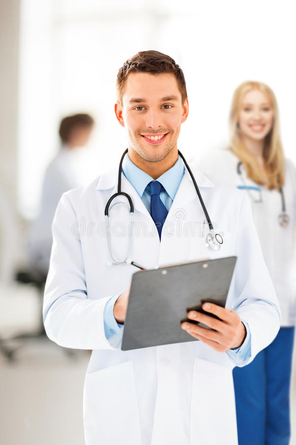 Download Male Doctor Writing Prescription Stock Photo - Image: 38070346