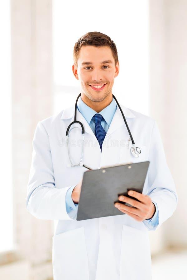 Male Doctor Writing Prescription Stock Photo