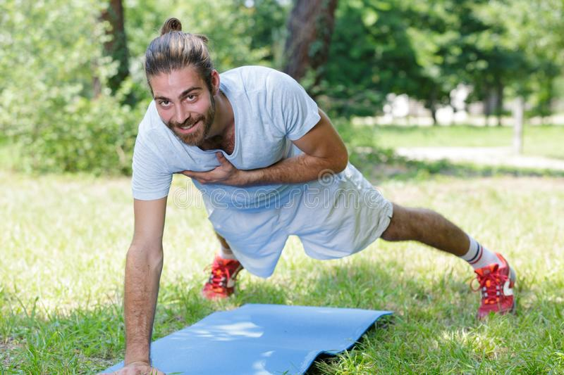 Male doing plank exercise. Male doing a plank exercise royalty free stock image
