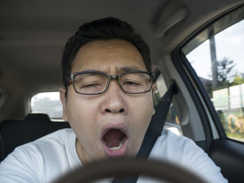 Male Driver Get Bored in His Car royalty free stock photography