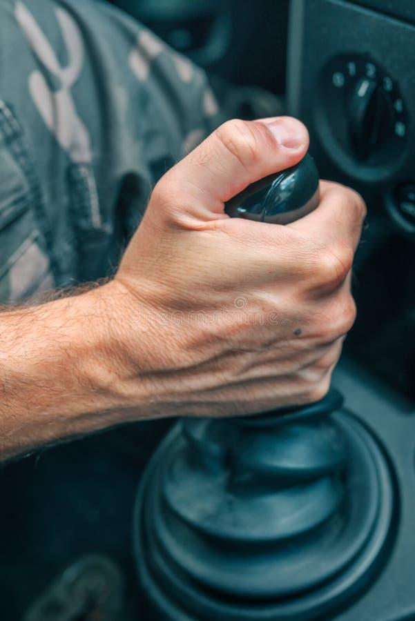 Male driver hand shifting gear manually. Selective focus stock photos