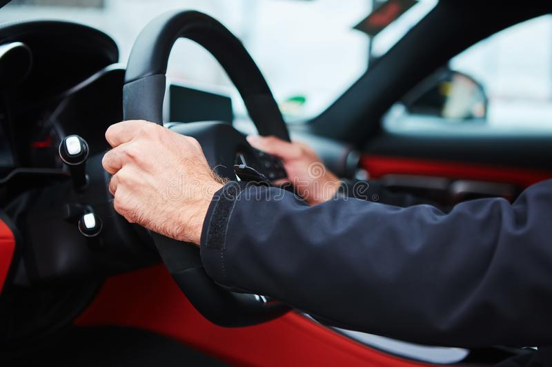 Male driver hands holding steering wheel. The male driver hands holding steering wheel royalty free stock photos