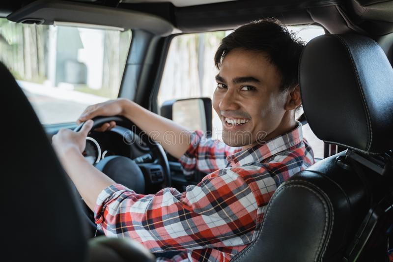 Male driver looking at the back. While driving his car stock images