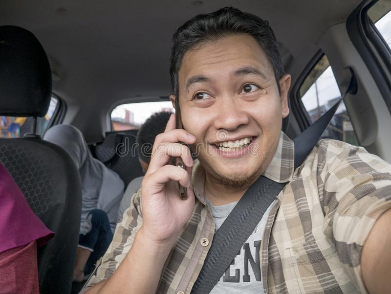 Male Driver Making a Call While Driving a Car stock photography