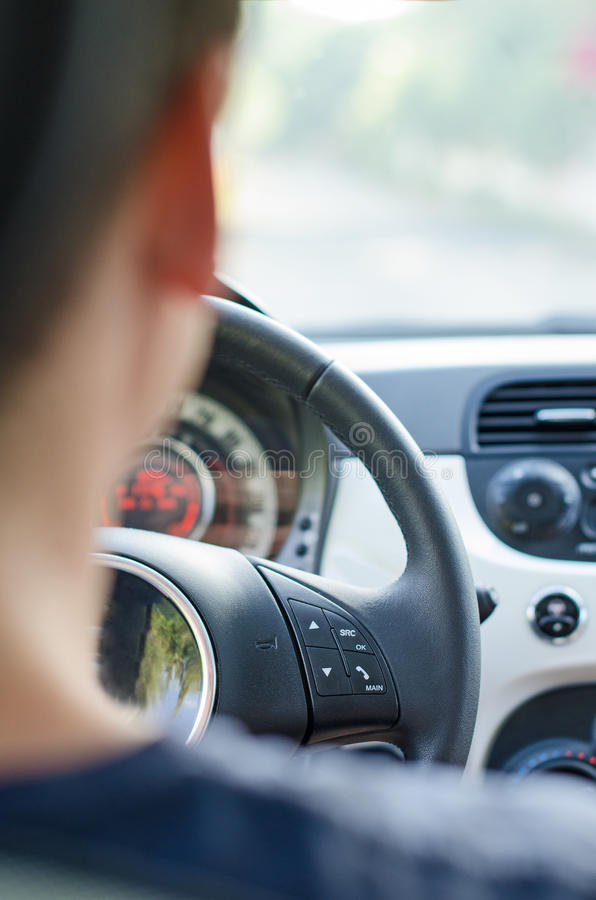Male driver view. From the back seat stock photos