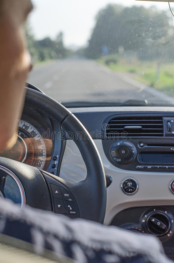 Male driver view. From the back seat royalty free stock photo