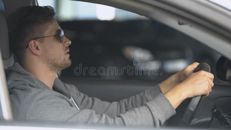 Male driver wearing polarized sunglasses, protecting eyes for safe driving. Stock photo royalty free stock photography