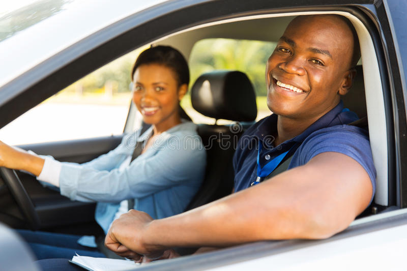 Male driving instructor stock photo