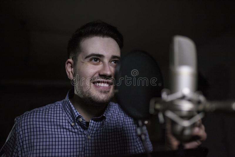 Male dub actor in dubbing room royalty free stock images