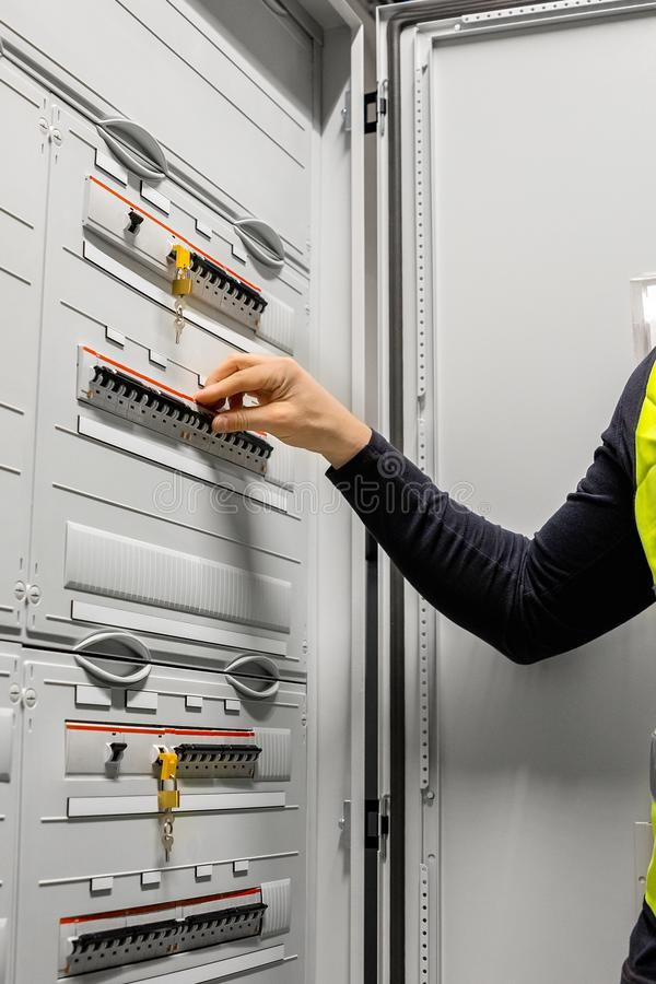 Male Electrician Checking Electric Fuse Board In Server Room stock images