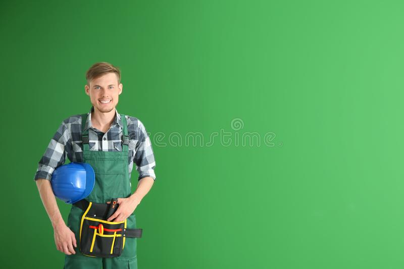 Male electrician on color background royalty free stock photography