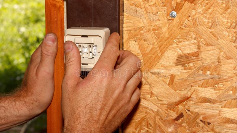 Male electrician sets electrical switch stock images